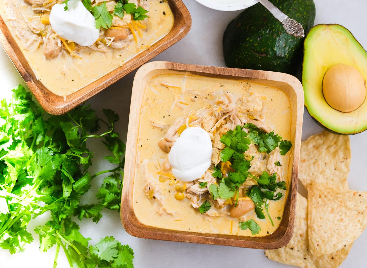 white chicken chili in two bowls with cilantro