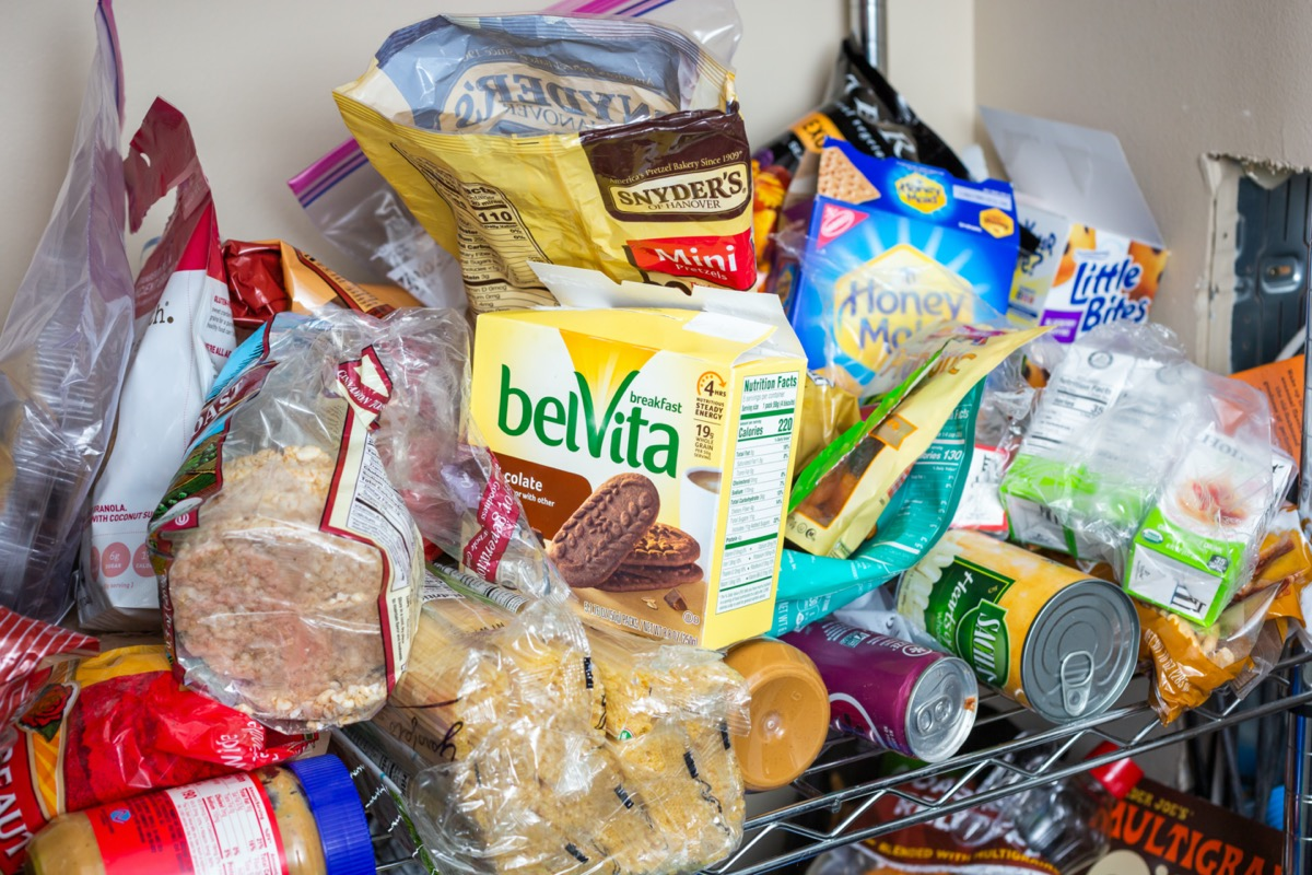 Seattle, California/United States - 10/24/2019: A view inside a food pantry, featuring an array of assorted food and beverage products and packages in a disorganized fashion.
