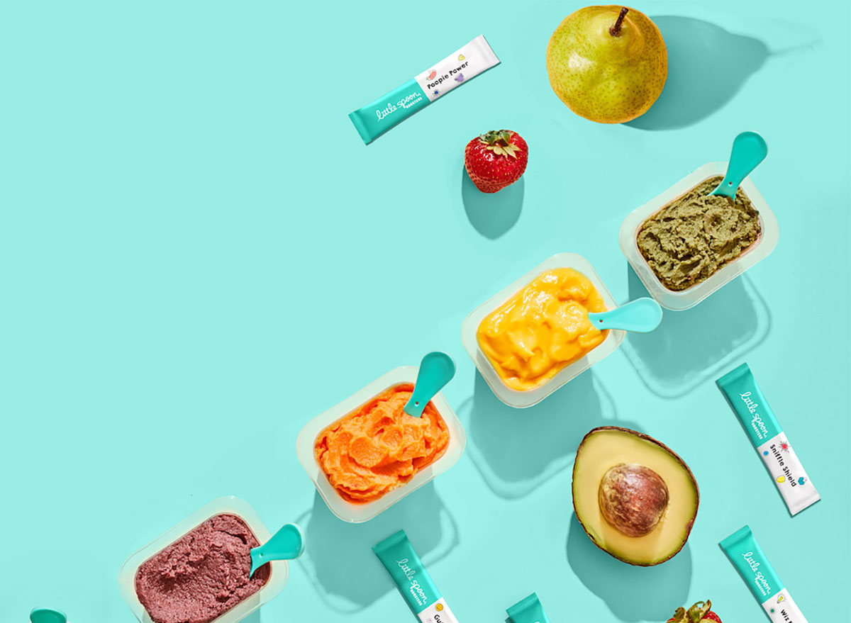 baby food containers on teal background