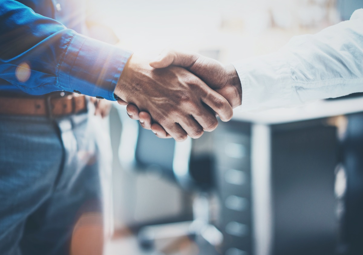 two businessman handshaking process