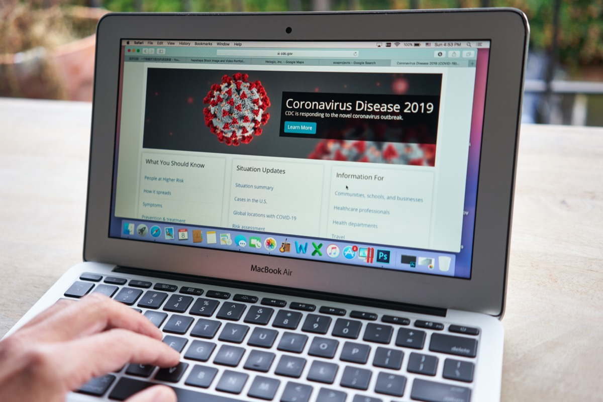 A man browsing the CDC website to learn key facts about the Coronavirus Disease 2019