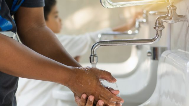 Man washing hands.