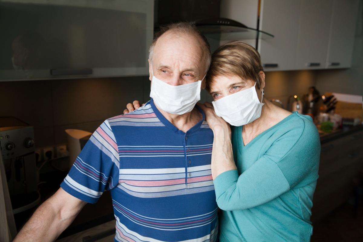 Seniors couple wearing medical face mask and recovery from the illness in home. quarantine. health