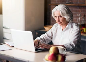 older woman looking at laptop