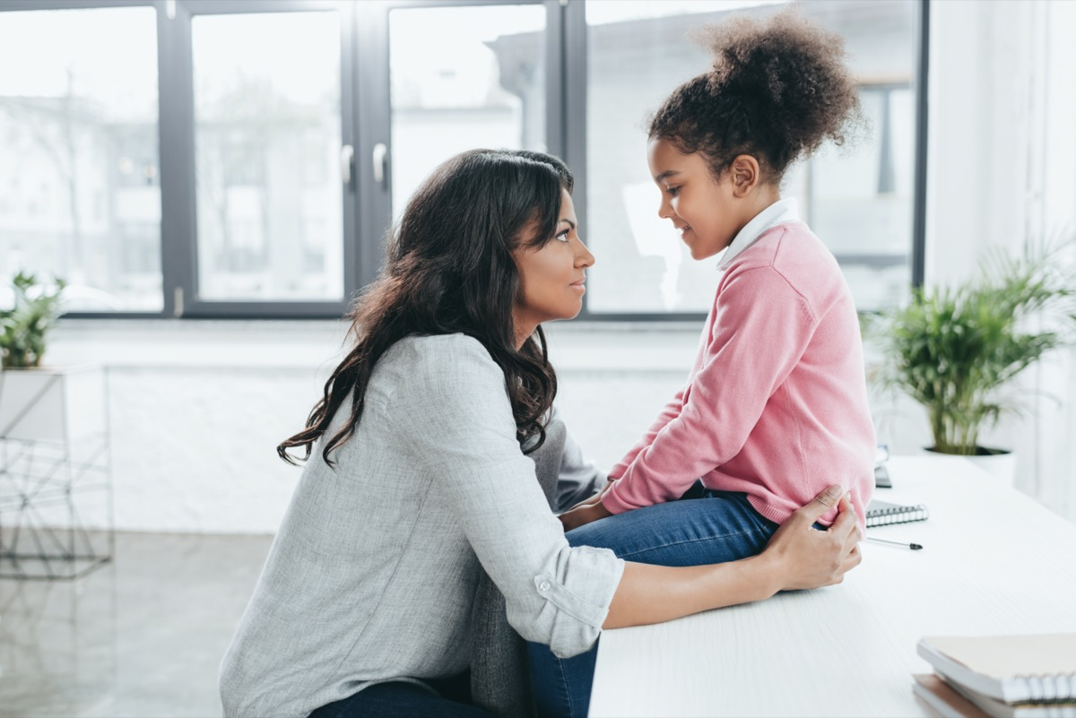 mother talking with her daughter indoors