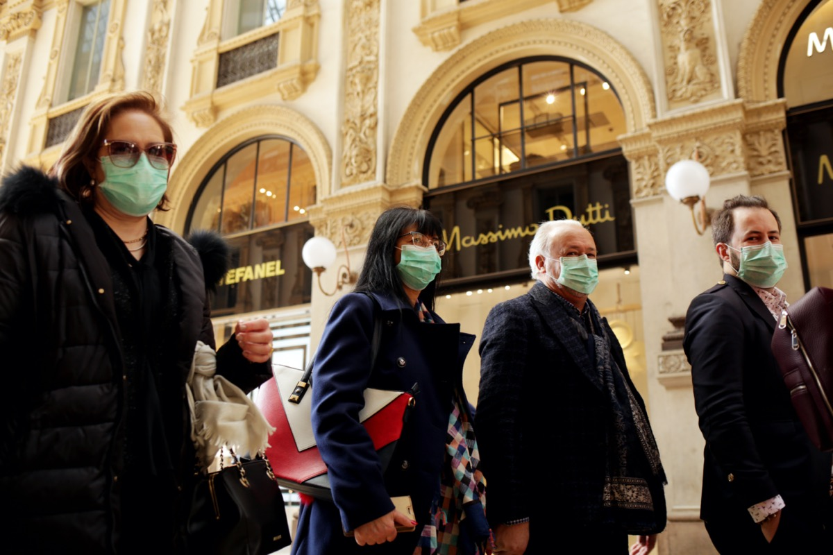 Coronavirus in Italy.Protective mask.Tourists in face masks at the Wiktor Emanuel II Gallery