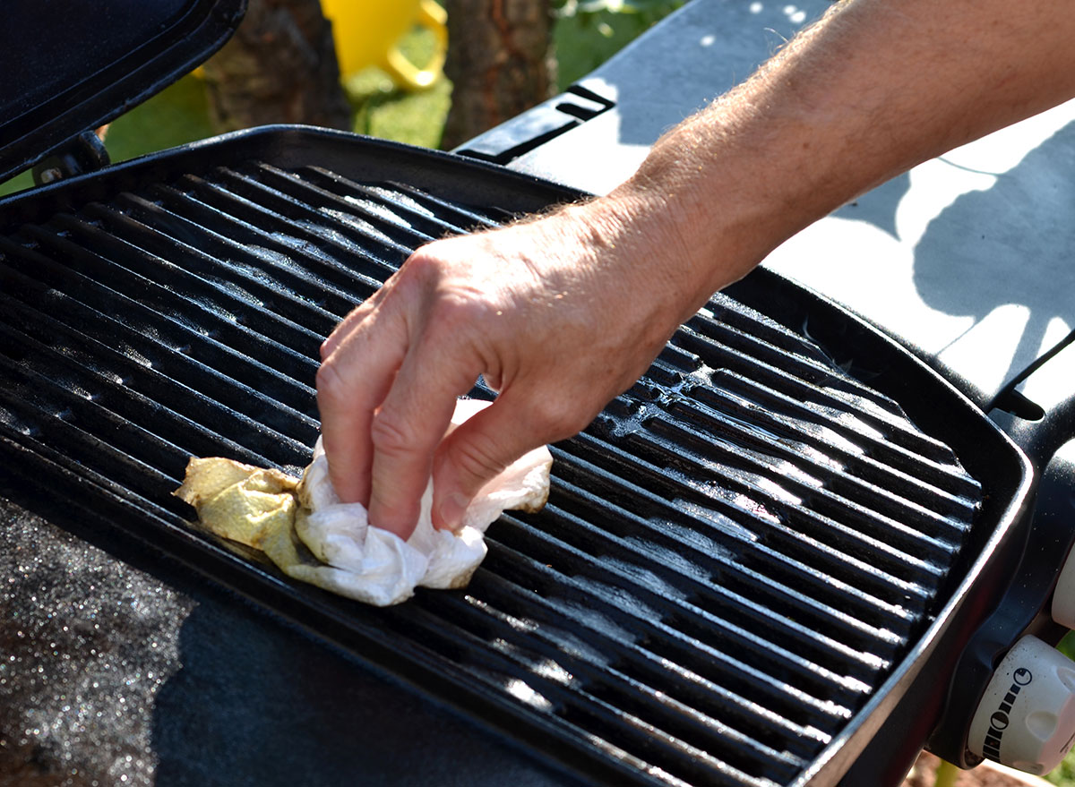 Person cleaning grill