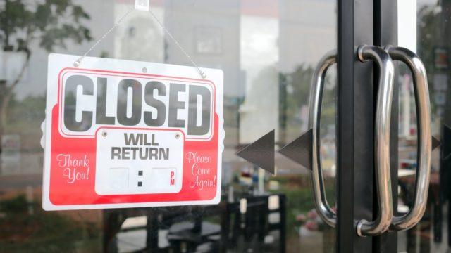 Sign closed in restaurant blank for fill time.