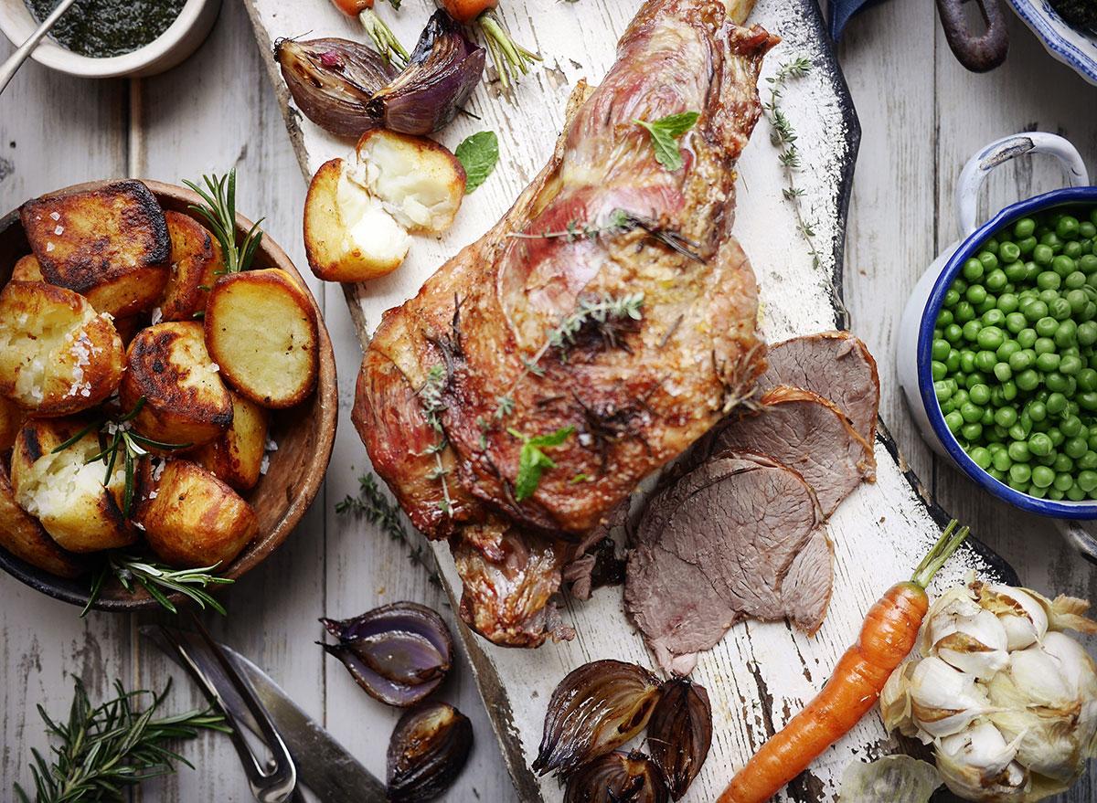 roast leg of lamb with potatoes, garlic, peas