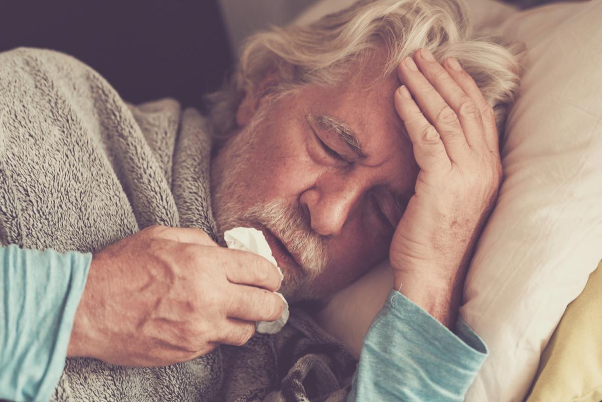 senior man with winter seasonal illness fever cold problems
