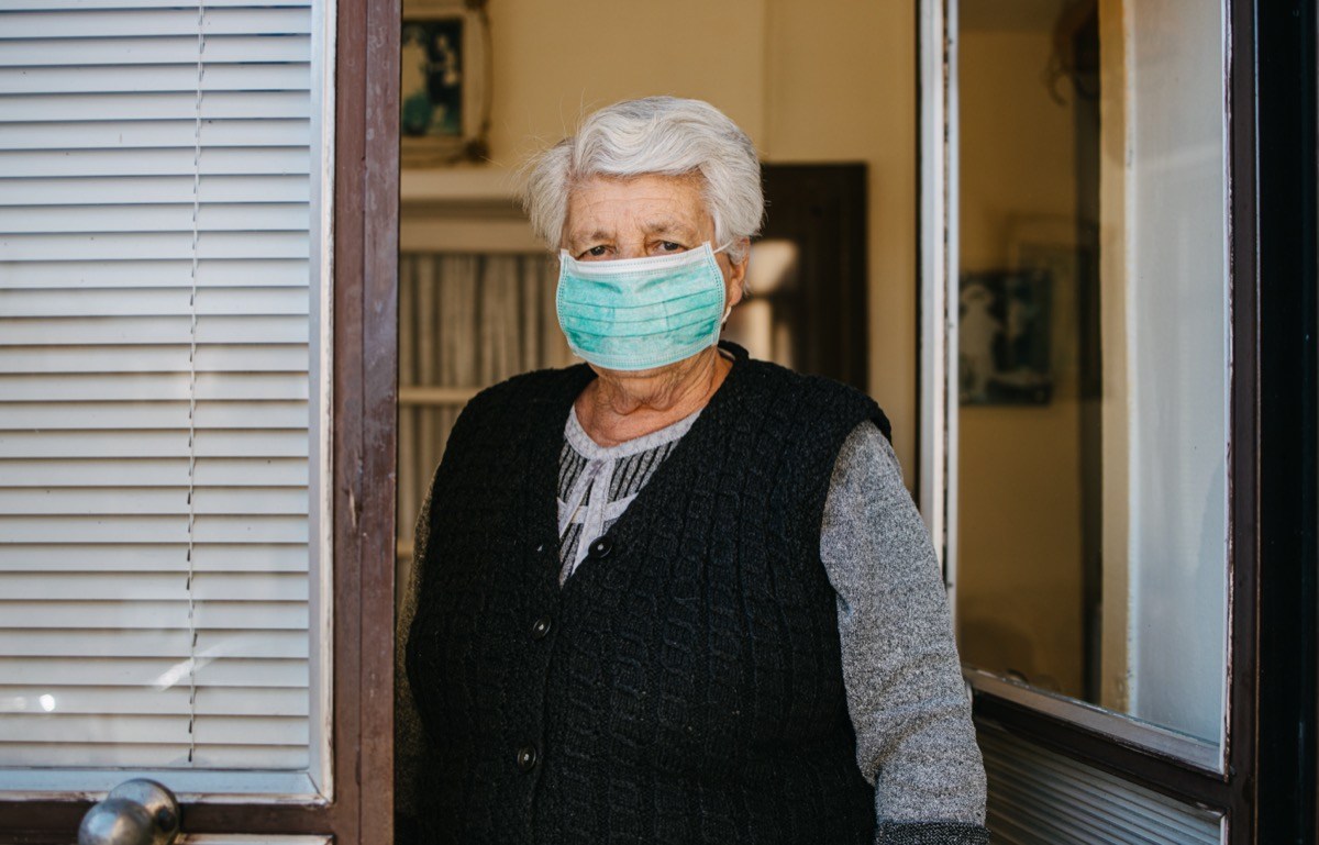 man wear mask and get a cold and cough outdoor