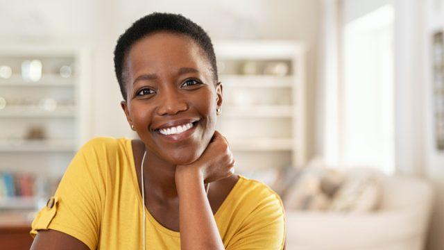 Smiling woman kitchen home