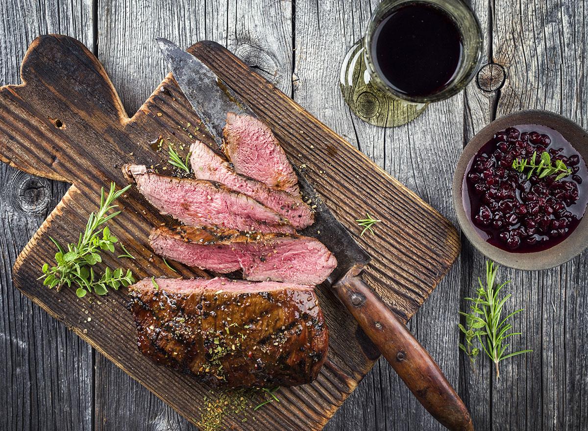 venison steak on cutting board