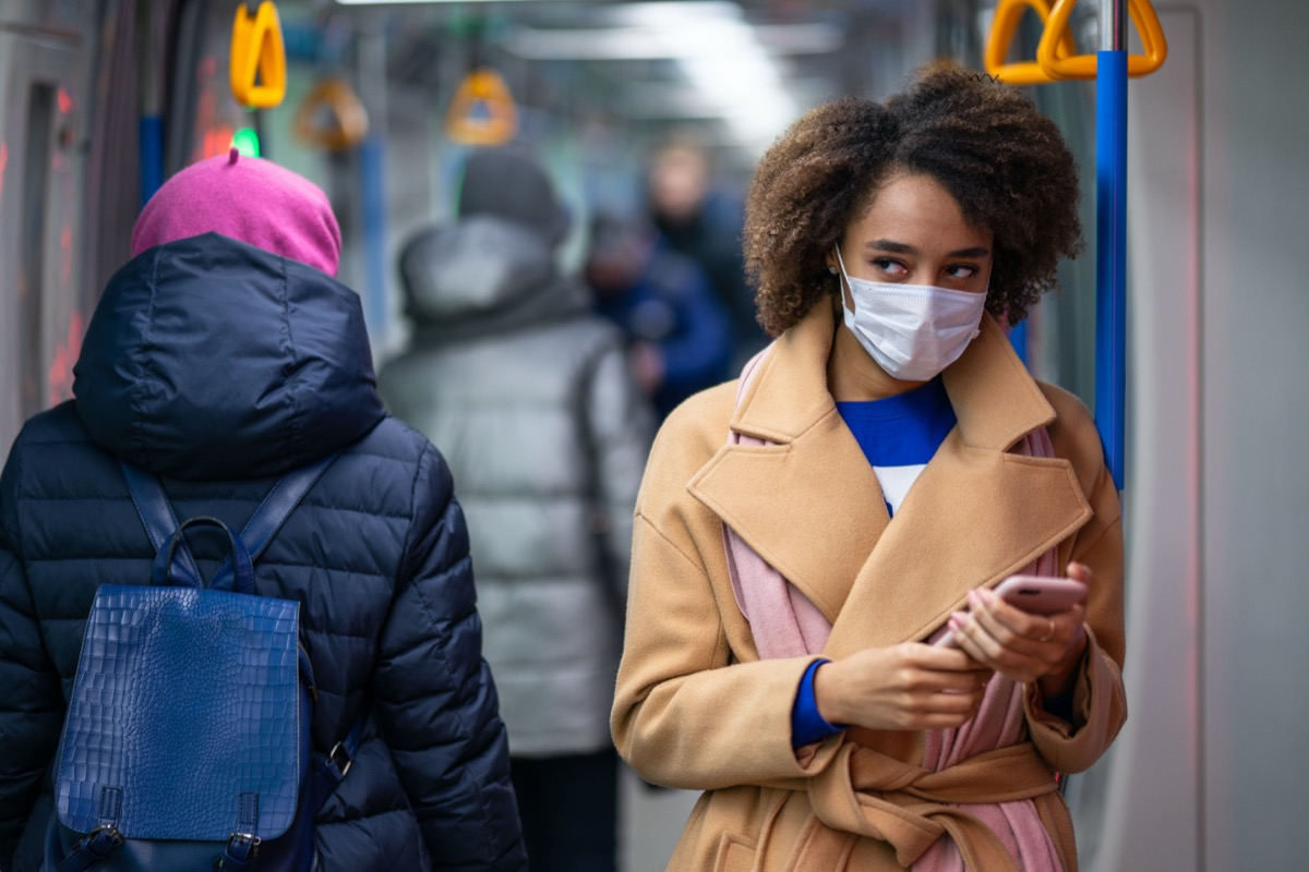 Woman in a medical mask in subway/