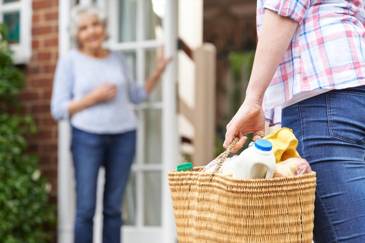 Person Doing Shopping For Elderly Neighbor