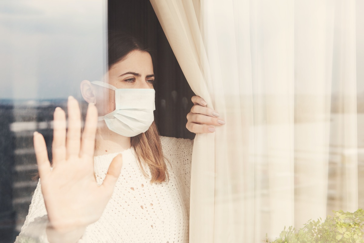 woman in medical mask stay isolation at home for self quarantine