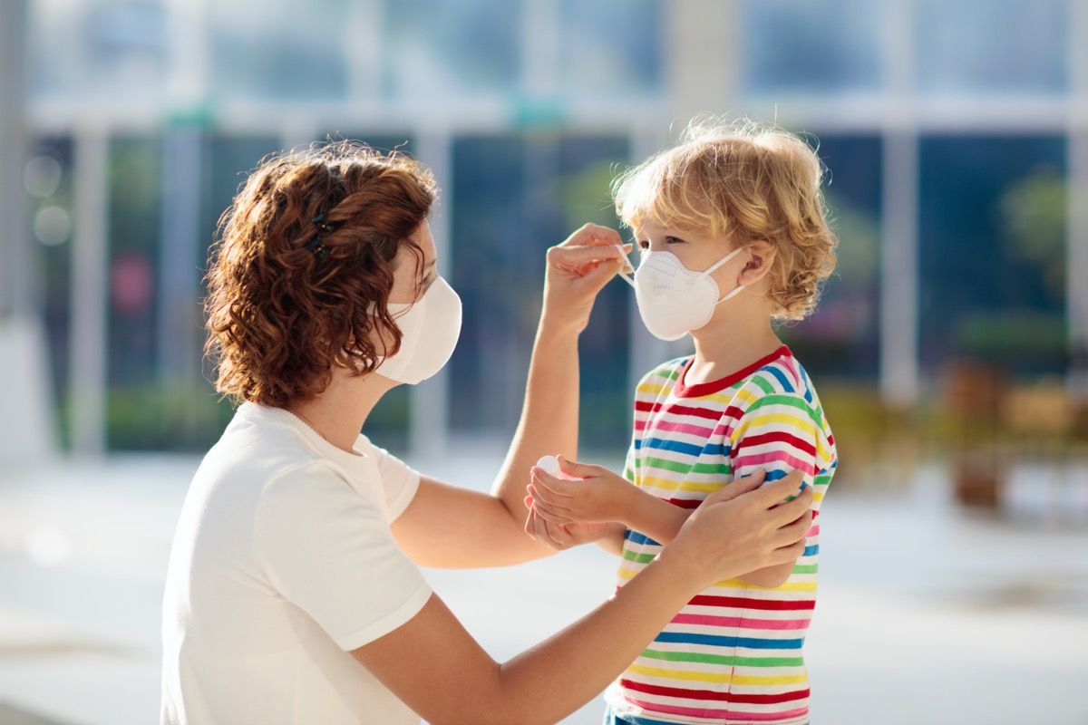 Mother and child wear facemask during coronavirus and flu outbreak.