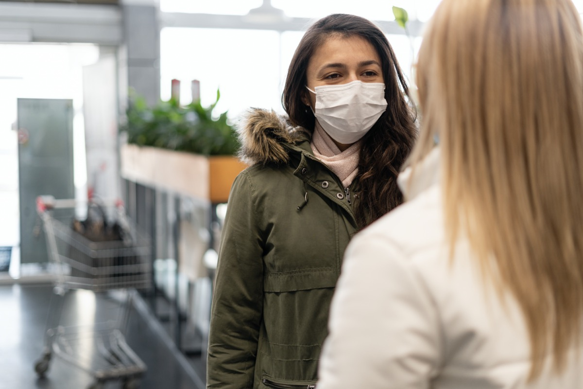 woman traveler wearing face protection in the prevention of coronavirus.