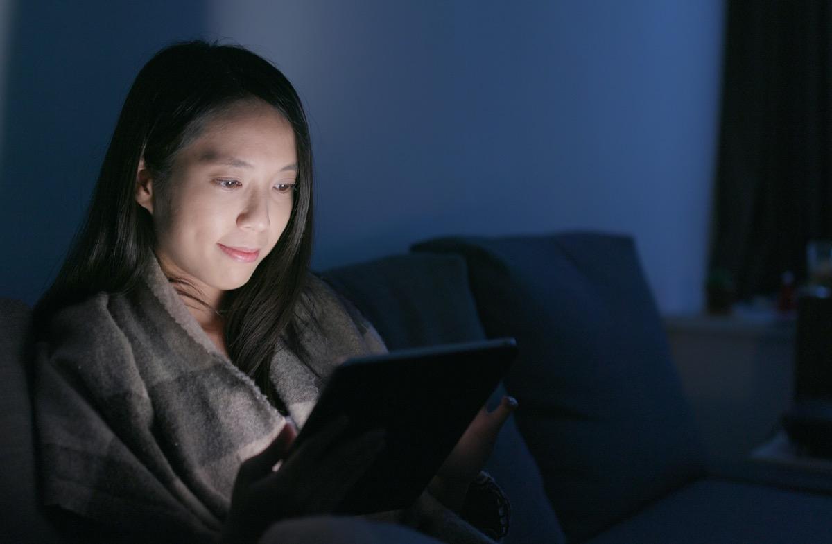 Woman look at tablet computer at home