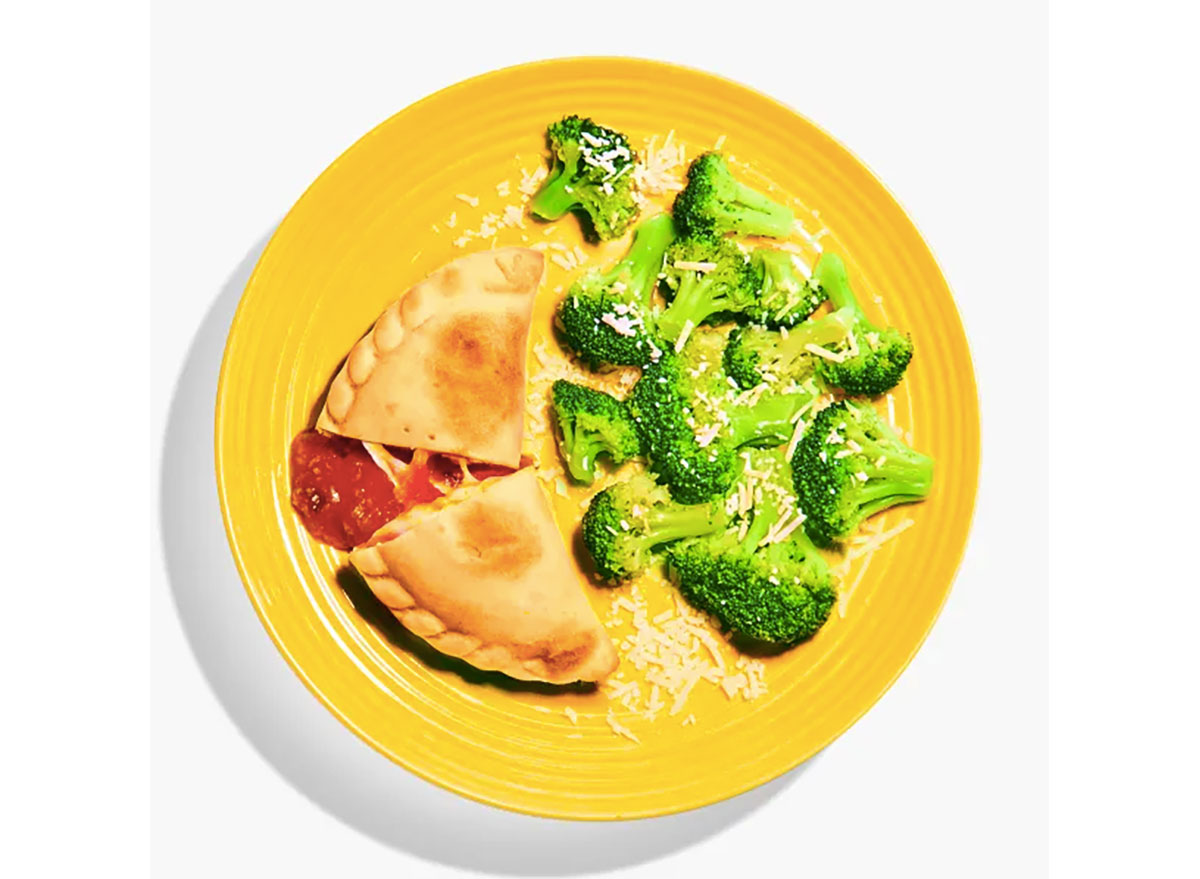 yumble kids meal pizza pocket broccoli on yellow plate