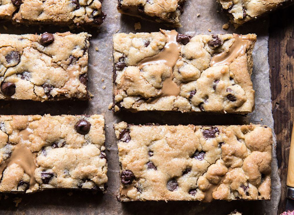 Chocolate chip and peanut butter swirled cookie bars recipe from Half Baked Harvest