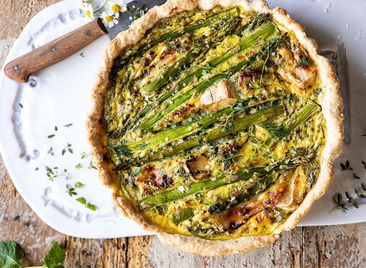 asparagus and brie quiche on platter