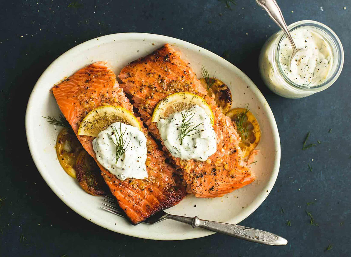 baked salmon with dill sauce on plate