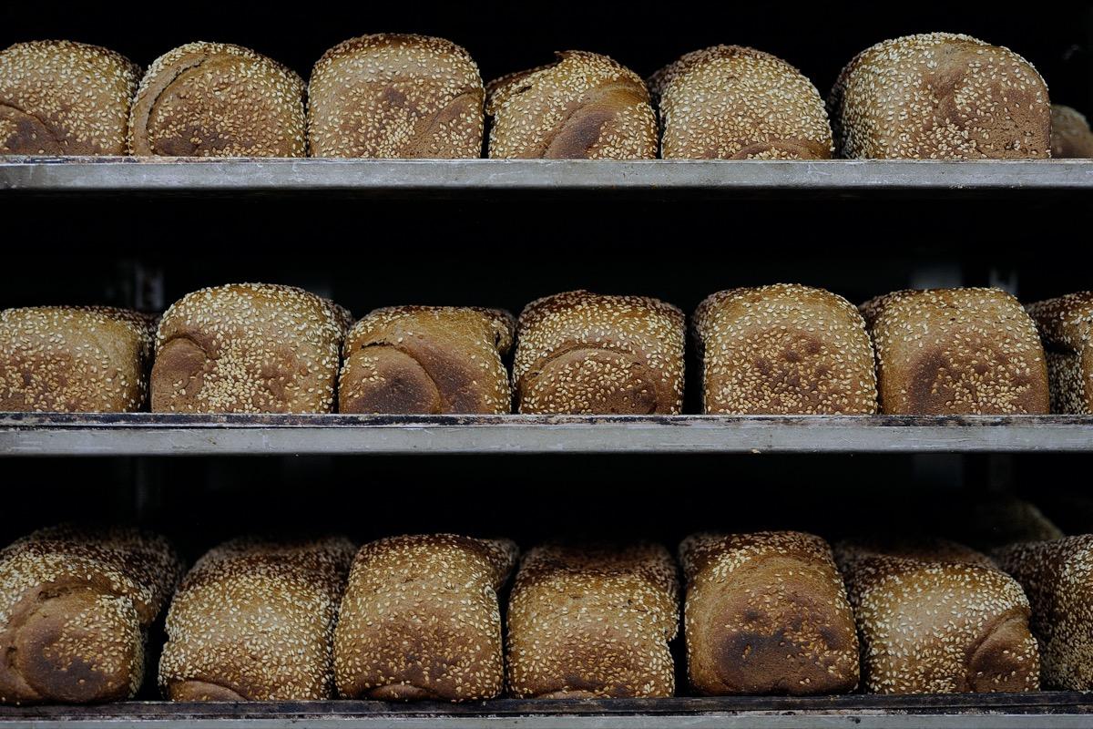 Bread loafs on a bakery shelve.