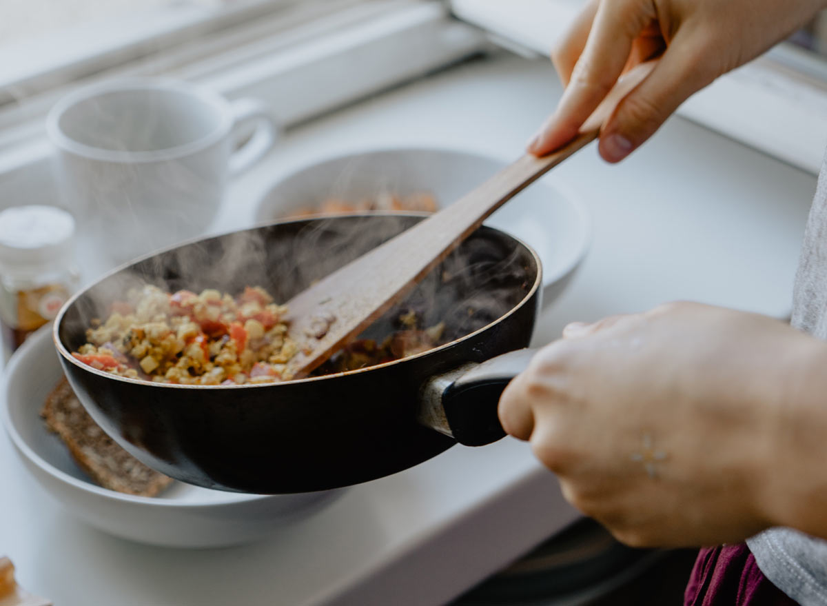 cooking a healthy meal in a skillet