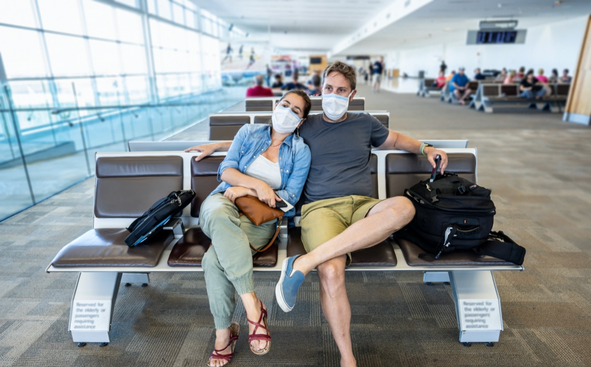 Couple with face mask stuck in airport terminal
