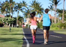 Runners athletes running training legs on road in residential neighborhood