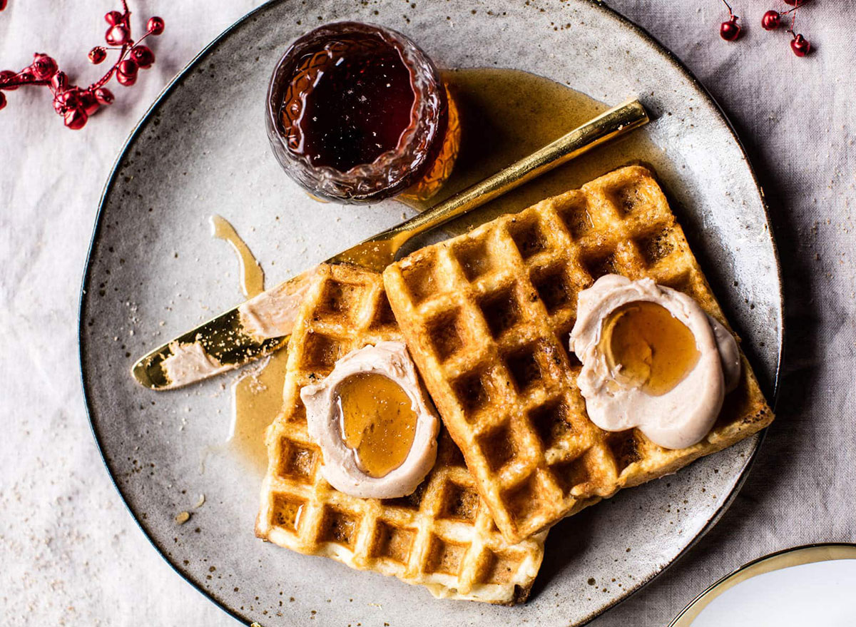 belgian waffles on plate with butter and preserves