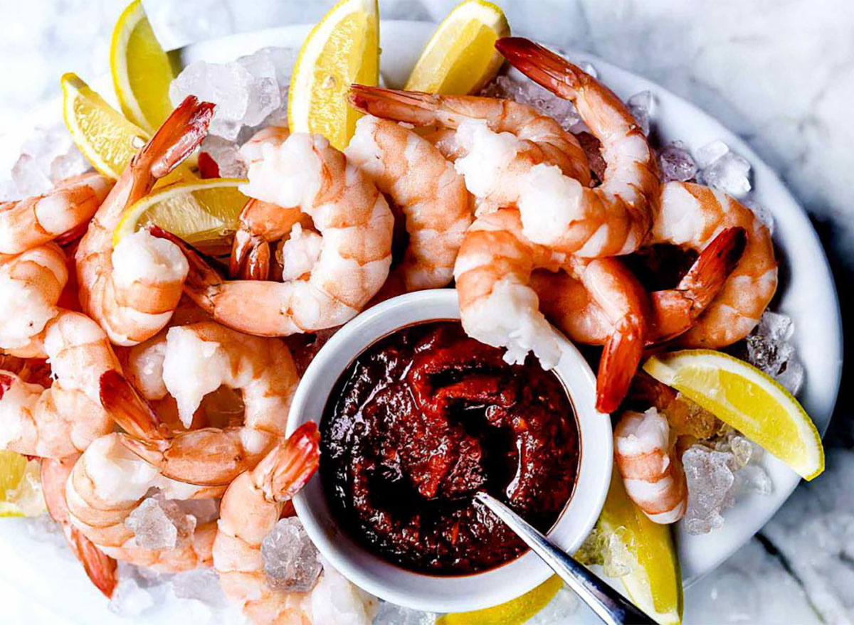 shrimp cocktail on ice with cocktail sauce