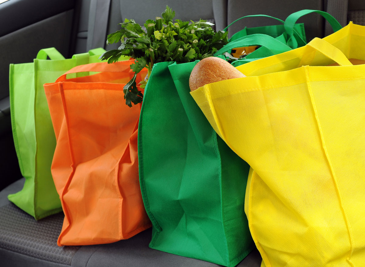 grocery bags sitting in back of car