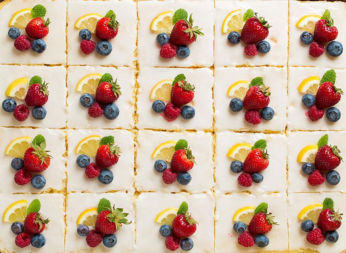 slices of lemon sheet cake topped with fresh fruit