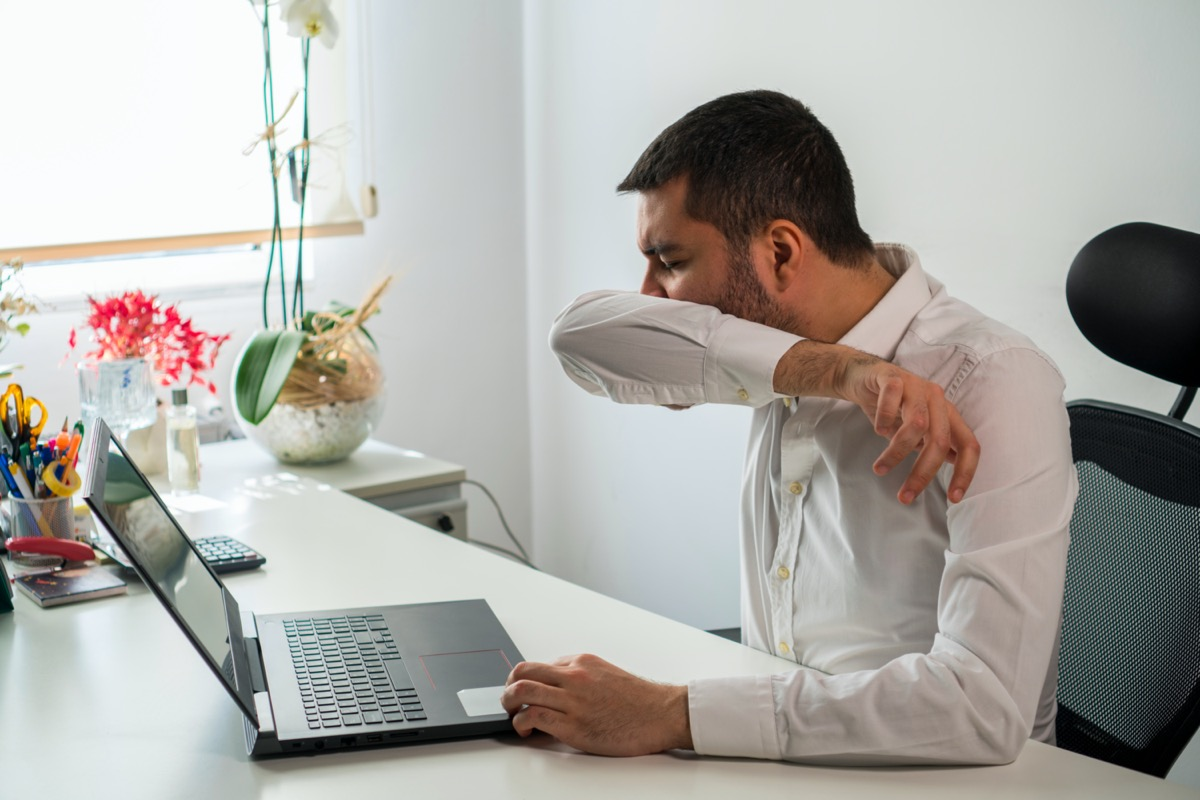 Young Business Man Sneezing. Coughing Into His Sleeve or Elbow to Prevent Spread Covid-19. Corona Virus
