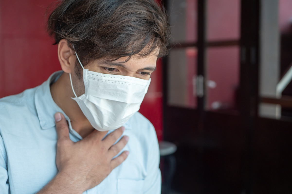 man wearing air filter mask having Dyspnea, breathing difficulty, respiratory distress in unhealthy, danger, polluted air environment