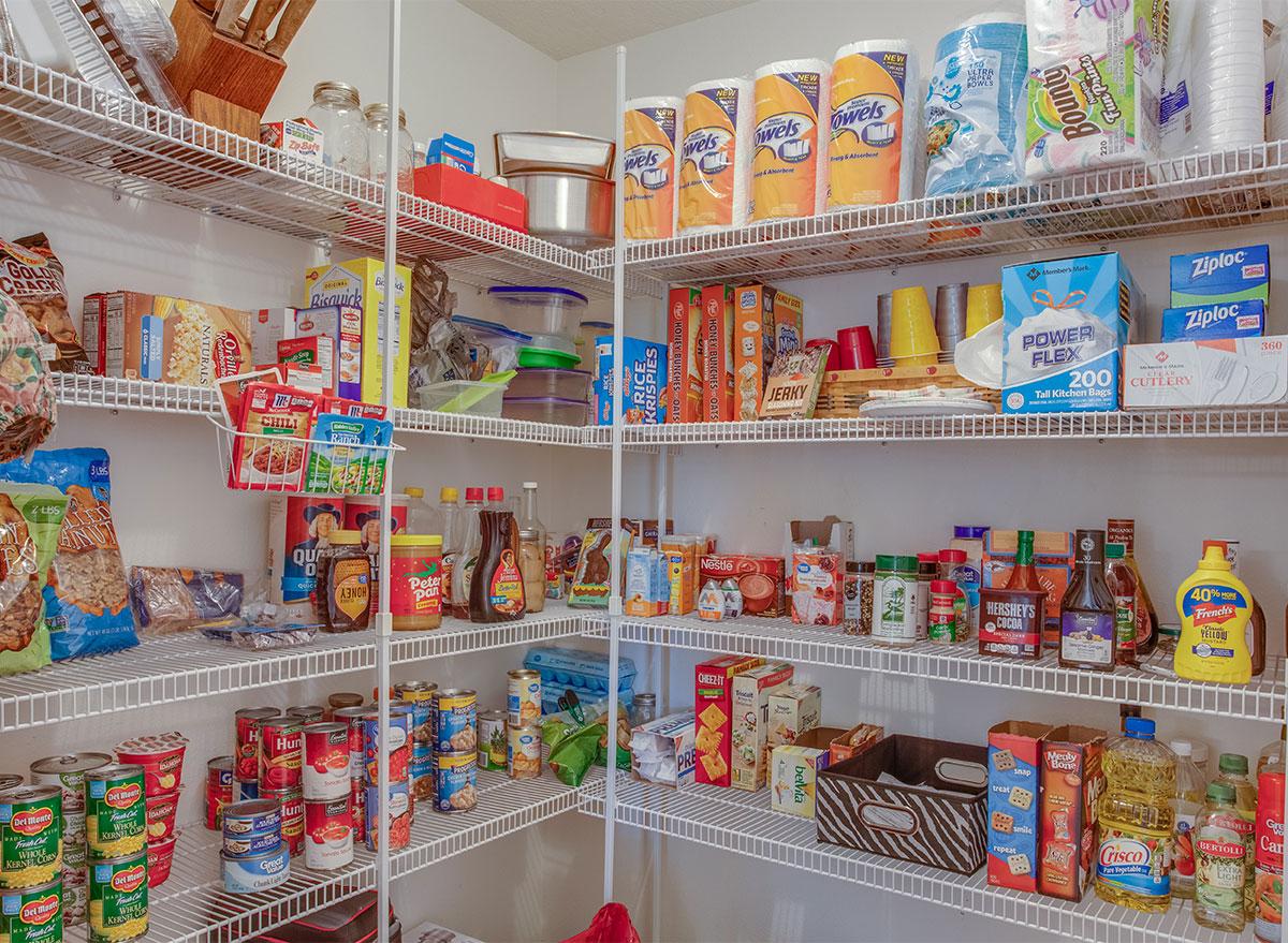 organized pantry stocked shelves