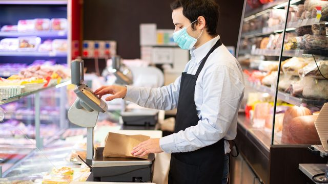 shop employee with mask