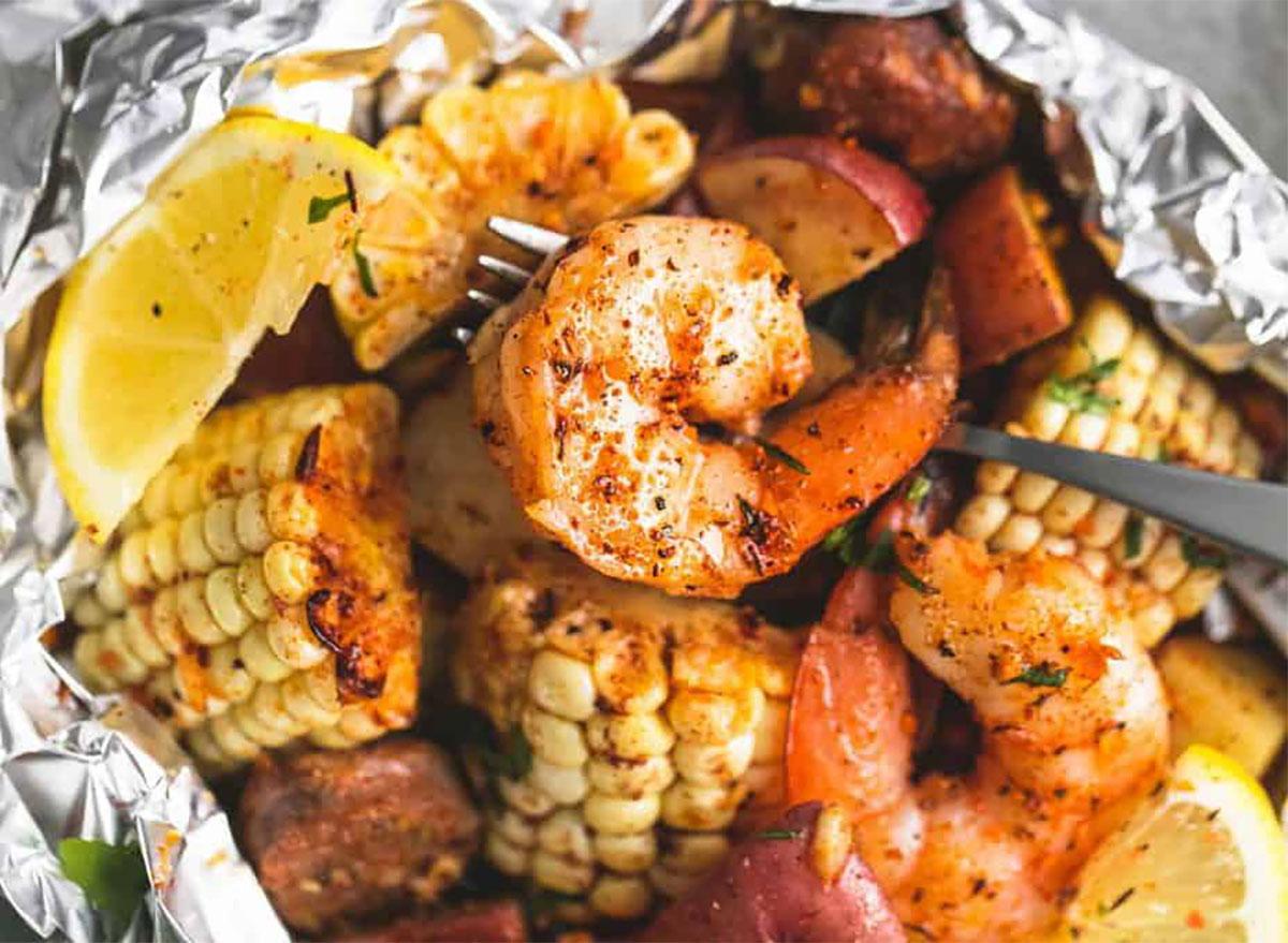shrimp boil foil pack with corn and lemon