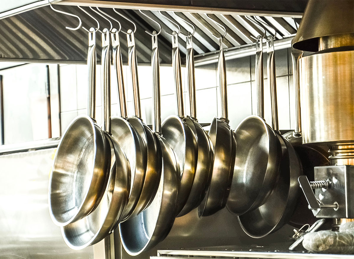 stainless steel pans on hanging rack