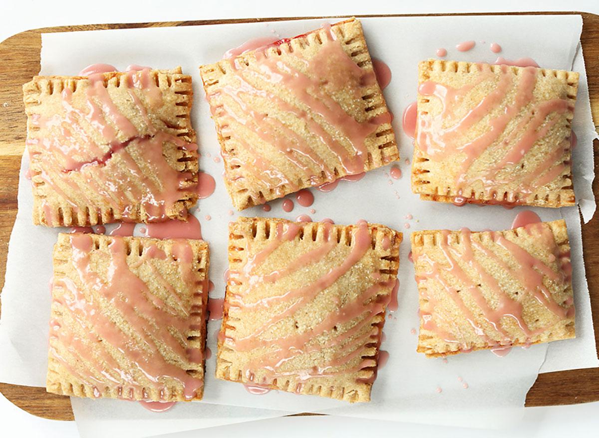 strawberry rhubarb poptarts on baking sheet