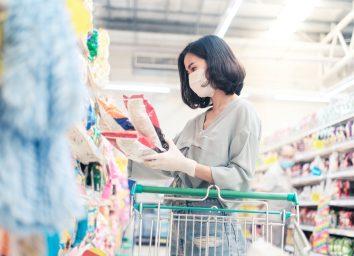 choosing, looking grocery things to buy at shelf during coronavirus crisis or covid19 outbreak