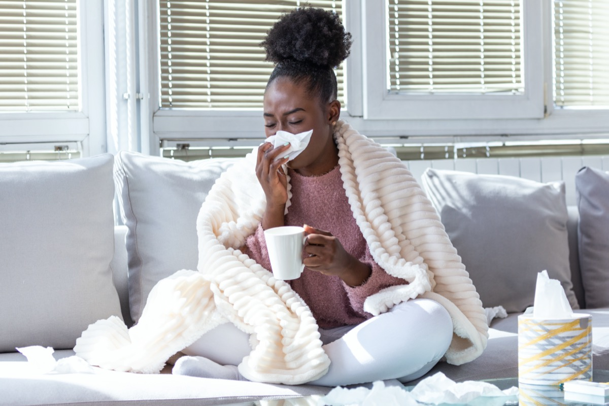 woman has runny nose and common cold