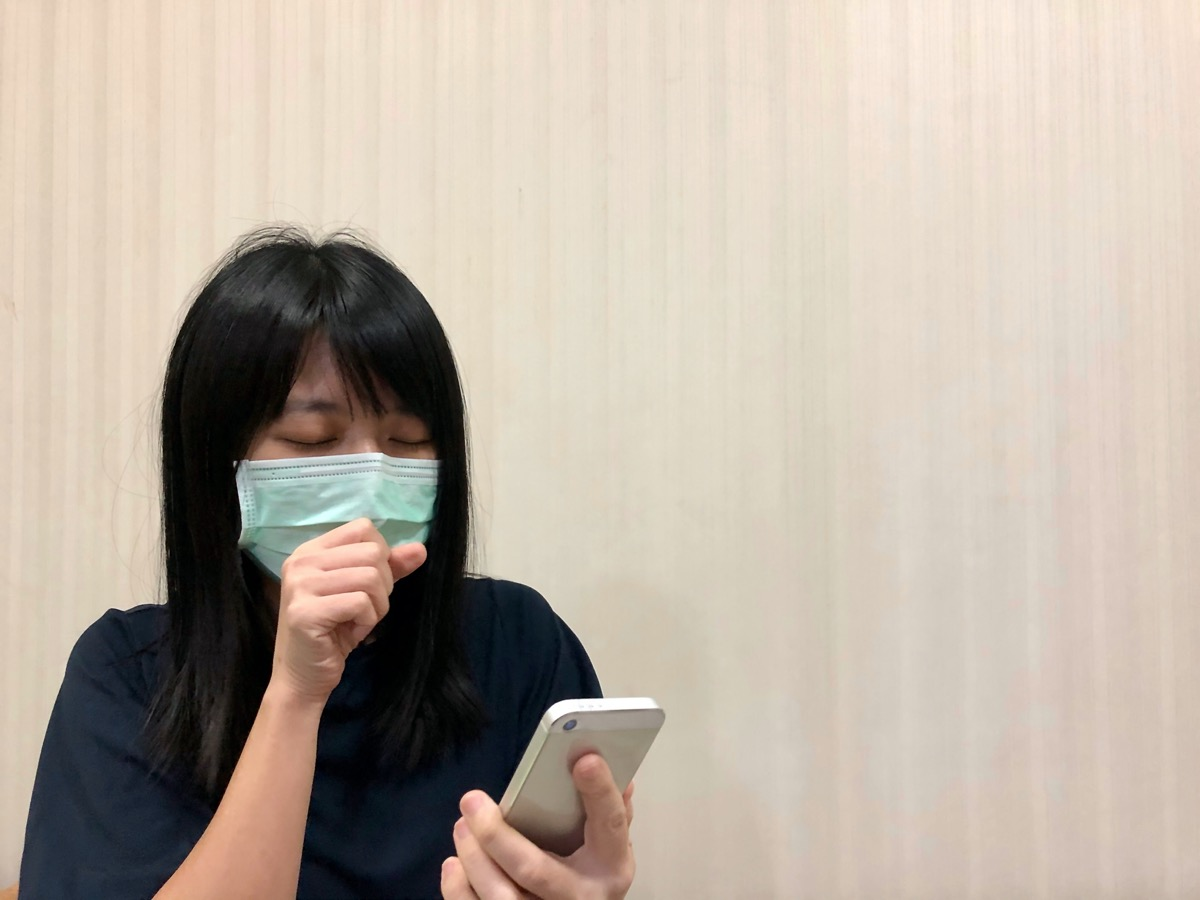 Asian female model wearing green surgical face mask