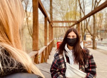 two girls wearing protective masks during coronavirus quarantine