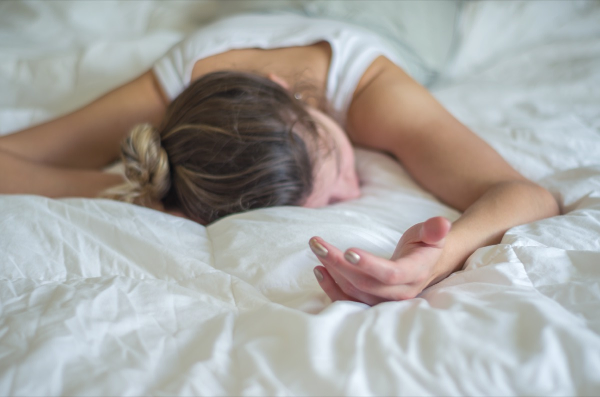Young woman, blond hair, fainted in bed.