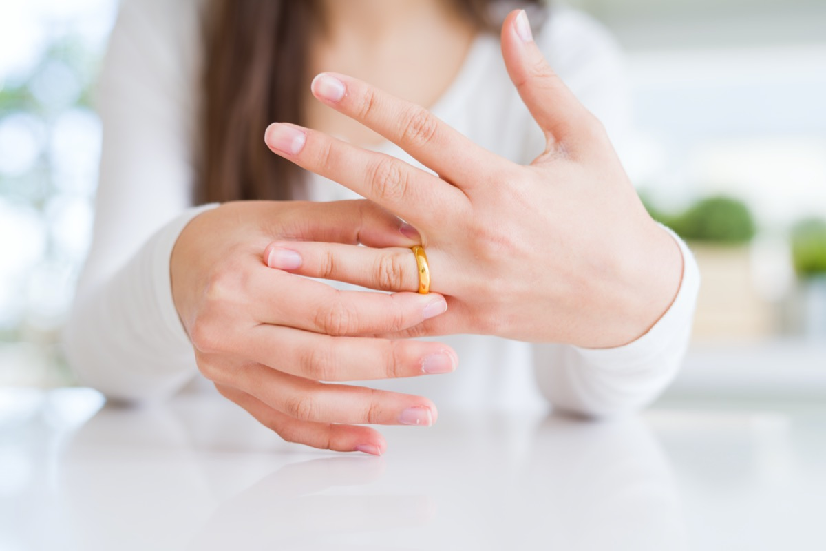 Close up of woman hands wearing wedding alliance ring