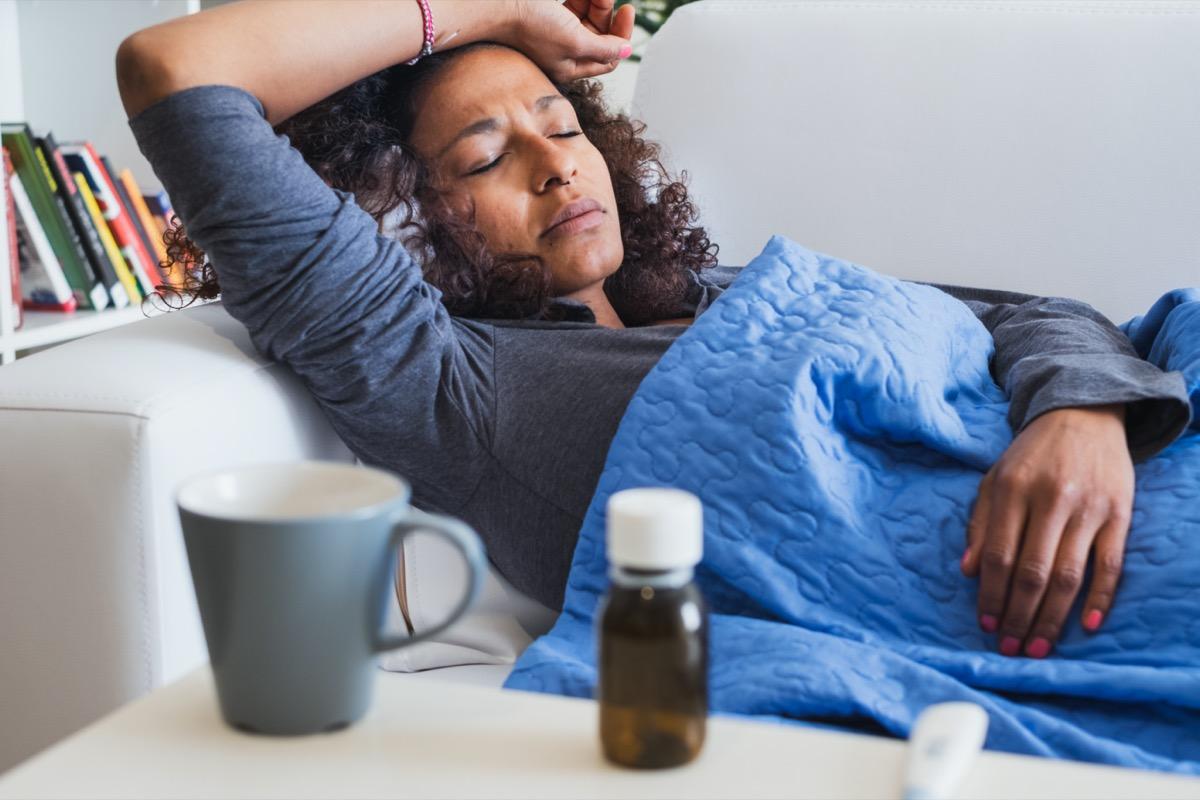 woman feeling sick and seasonal flu symptoms