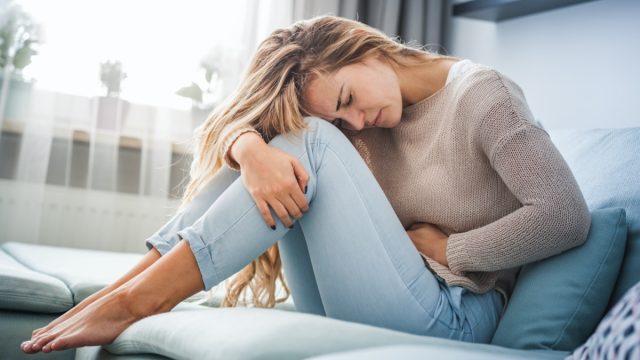 Woman stomach abdominal pain
